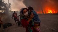 Gerade noch gerettet: Eine Migrantin bringt sich im Flüchtlingslager Moria mit ihrem Kind vor den Flammen in Sicherheit.