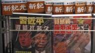 Blickfang am Kiosk in Peking: die Präsidenten Donald Trump und Xi Jinping