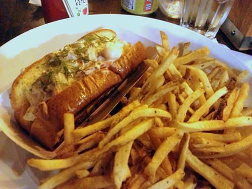 A plate of french fries and lobster roll