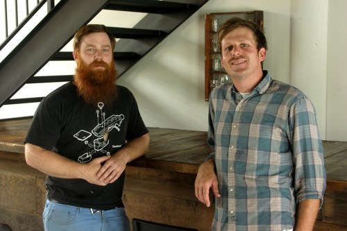Assistant brewer Brian Burgmeier and founder Eric McNeil at the bar that will anchor Aquanauts taproom, which they hope to open within six months