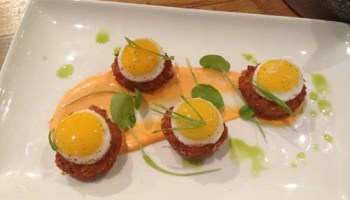 Ham and Gruyere croquettes with fried quail eggs and bechamel