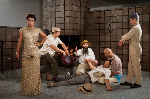 Im not too sure whats supposed to be happening in this Dengue Fever photo. It doesnt look the guys even told front woman Chhom Nimol about their little tableau.