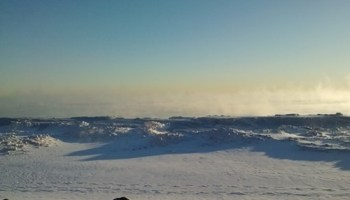 In January Lake Michigan looked like a tundra on another planet. Now its time to swim in it.