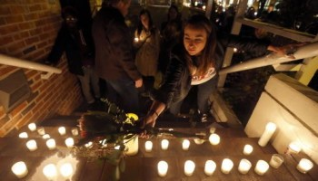 Jenifer Trotter, sister-in-law to Charlie Trotter, places a bouquet of flowers with candles on the steps of the latters former restaurant during a candlelight tribute to the chef last night.