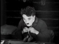 Lord of the dance: Chaplin plays with his food in The Gold Rush (1925)