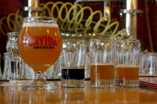 The lineup for Mondays DryHop tap takeover at the Bottle: High Plus Tight wheat IPA, Feeling That Surrounds Belgian-style stout, Saazquatch imperial pilsner, and Shark Meets Hipster wheat IPA