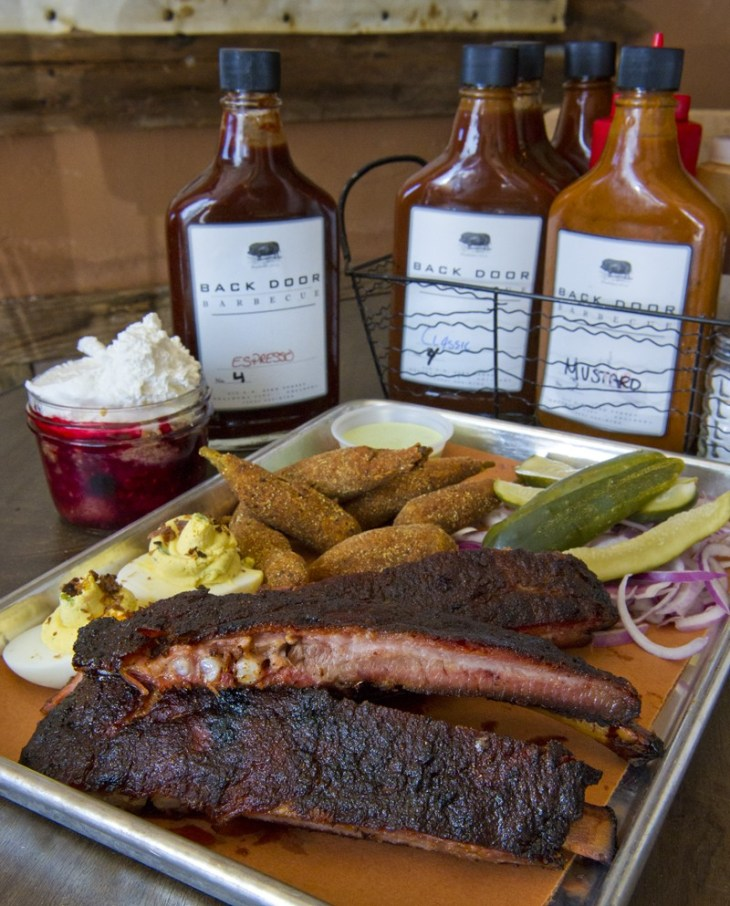 Backdoor BBQ ribs, homemade pickles & onions, fried okra, deviled eggs and  mixed fruit cobbler. Housemade BBQ sauces