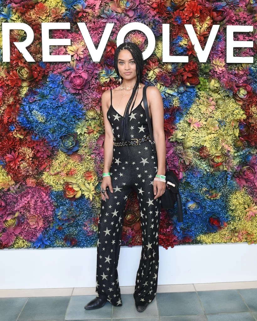 Shanina Shaik wearing a star-printed jumpsuit at the Revolve Festival party.