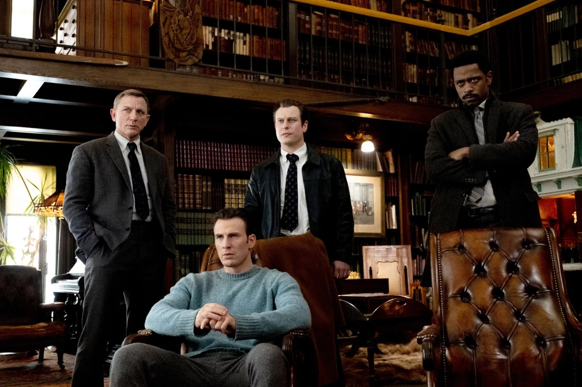 KNIVES OUT, standing from left: Daniel Craig, Noah Segan, LaKeith Stanfield; seated: Chris Evans, 2019. ph: Claire Folger / Lionsgate / courtesy Everett Collection