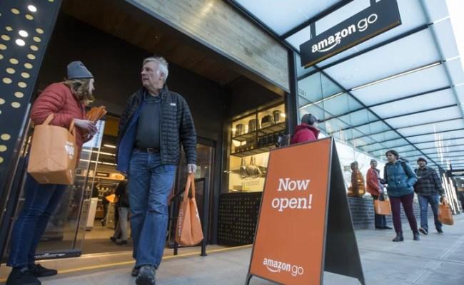 Shoppers Put Their Items In Orange Reusable Amazon Go