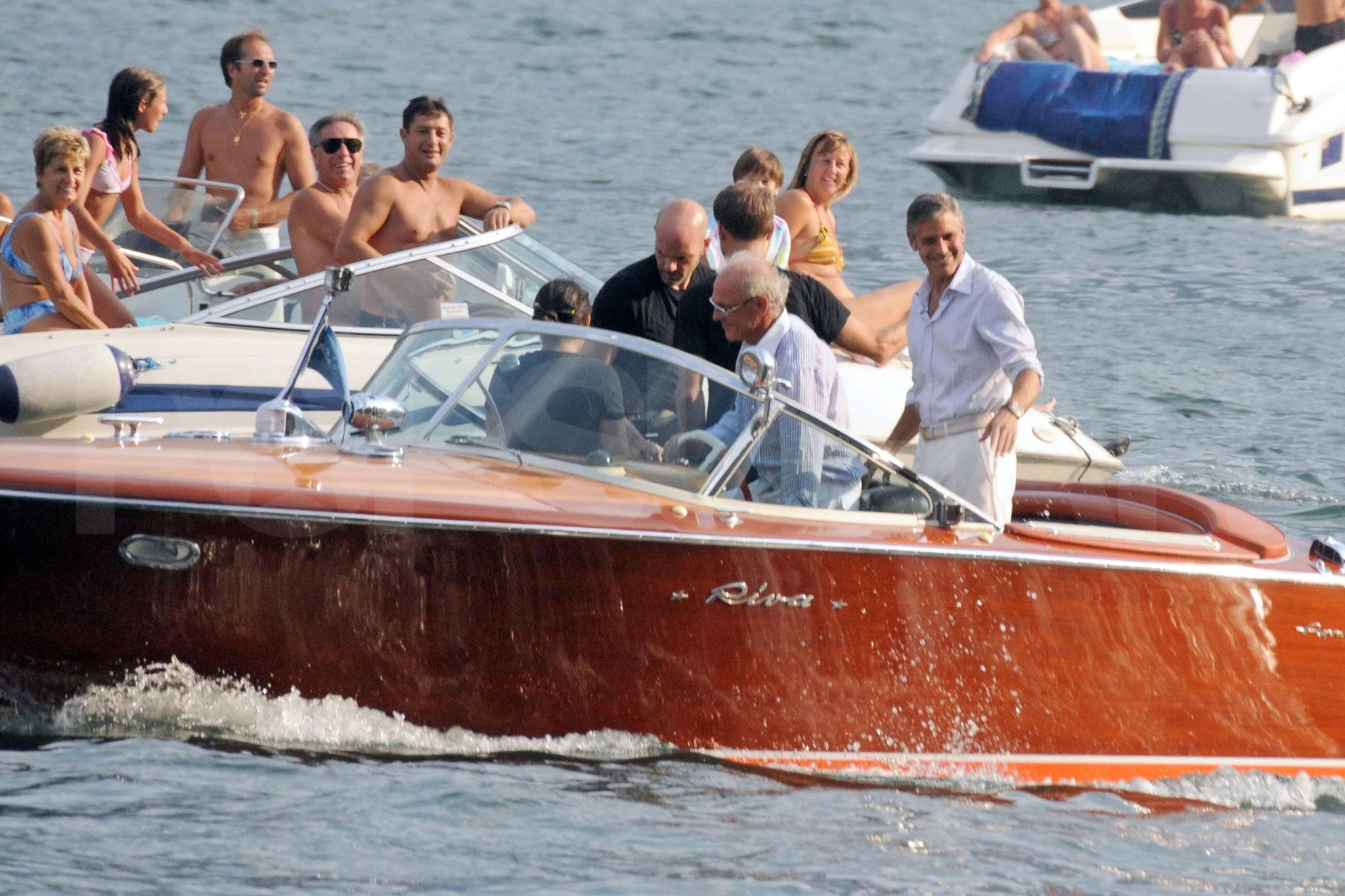 Photos Of George Clooney In Lake Como Suing Paparazzi For