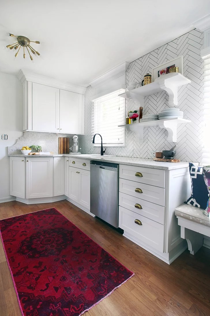 By switching around appliances and extending the cabinets