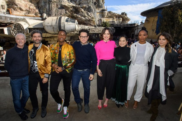 ANAHEIM, CA  DECEMBER 02:  In this handout photo provided by Disney Resort, the cast of the upcoming film, Star Wars: The Rise of Skywalker (L-R) Anthony Daniels, Oscar Isaac, John Boyega, director J.J. Abrams, Daisy Ridley, Kelly Marie Tran, Naomi Ackie and Keri Russell pose in front of the Millennium Falcon in Star Wars: Galaxys Edge at Disneyland Park in December 2, 2019 in Anaheim, California, while promoting  Star Wars: The Rise of Skywalker, in theaters December 20. (Photo by Richard Harbaugh/Disneyland Resort via Getty Images)