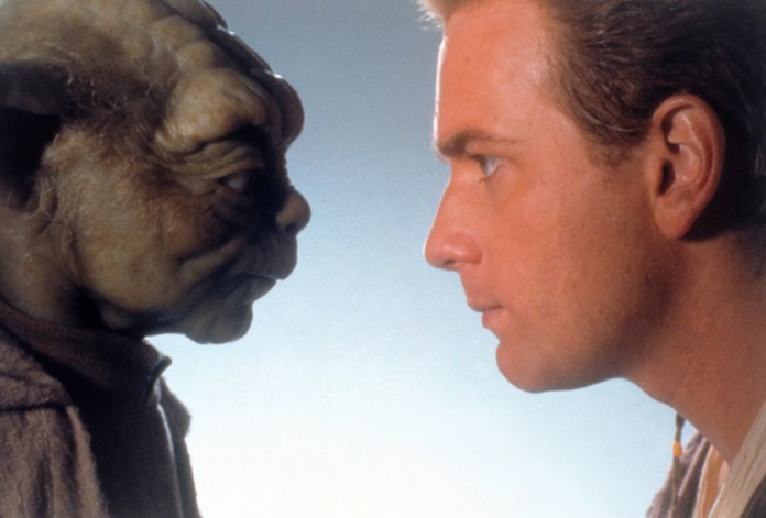 STAR WARS: EPISODE 1-THE PHANTOM MENACE, l-r: Yoda (performed by Frank Oz), Ewan McGregor, 1999. ph: Keith Hamshere/TM and Copyright  20th Century Fox Film Corp. All rights reserved./courtesy Everett Collection