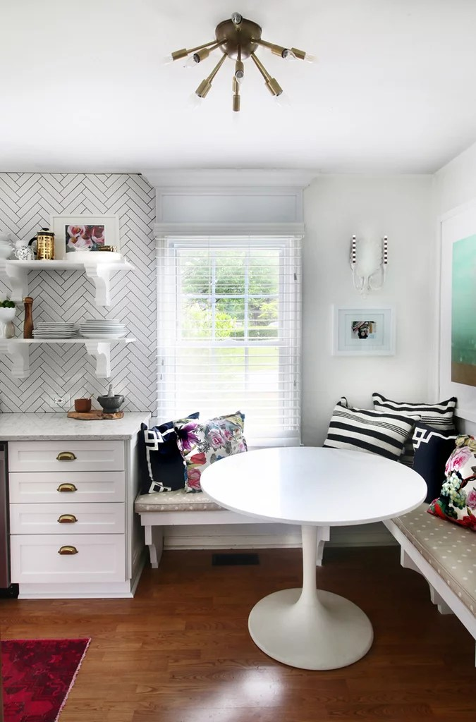banquette kitchen table utility cabinets for adding banquet seating and a round tulip makes it ...