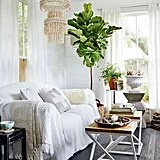 Throwing a large white bedspread over the sofa lends a bohemian vibe but can also cover up a dated piece of furniture. Source: Cody Ulrich via Homepolish
