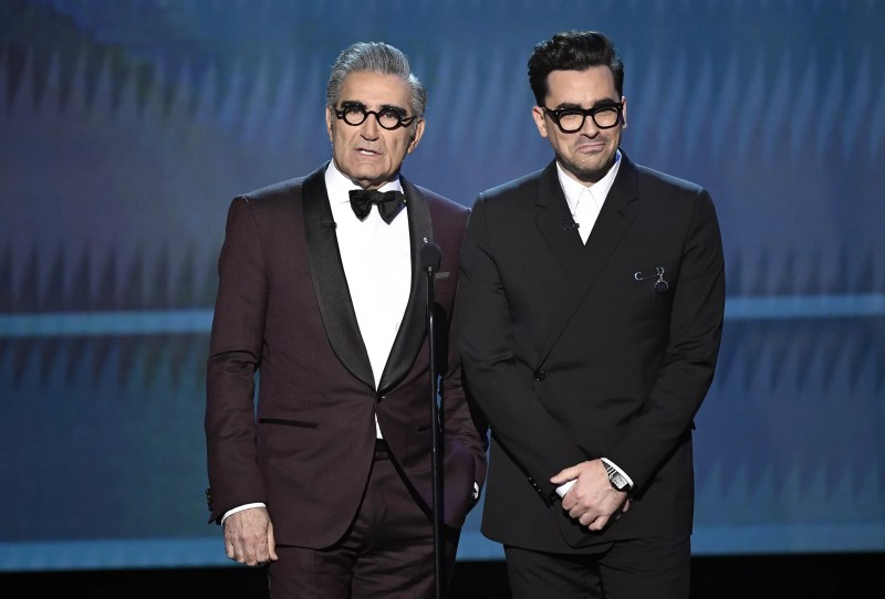 LOS ANGELES, CALIFORNIA - JANUARY 19: (L-R) Eugene Levy and  Dan Levy speak onstage at the 26th Annual Screen Actors Guild Awards at The Shrine Auditorium on January 19, 2020 in Los Angeles, California. 721359 (Photo by Kevork Djansezian/Getty Images for Turner)