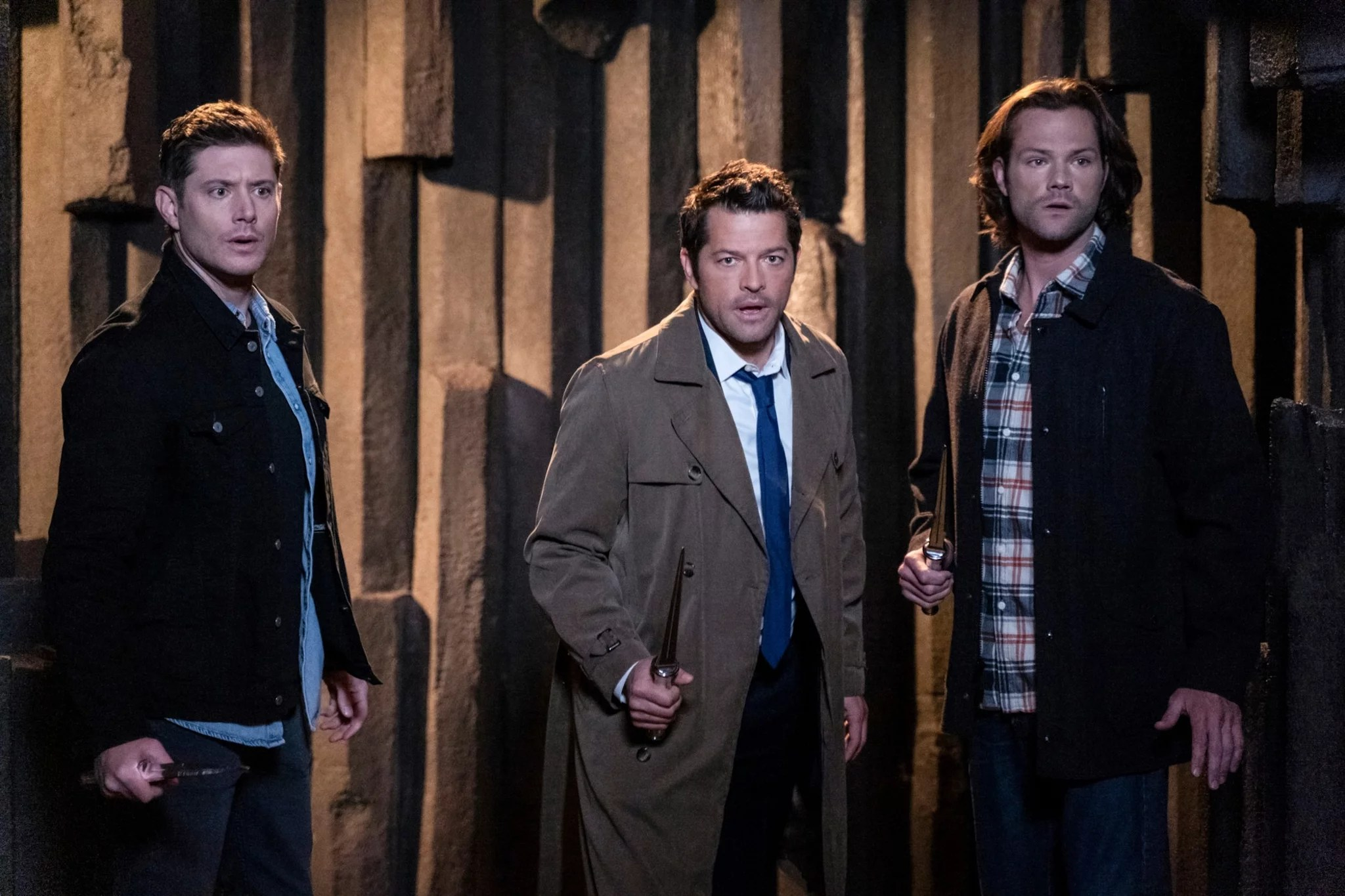 SUPERNATURAL, from left to right: Jensen Ackles, Misha Collins, Jared Padalecki, 'Our Father Who's Not in Heaven', (Season 15, episode 1508, released December 12, 2019), photo: Colin Bentley / The CW / courtesy Everett Collection