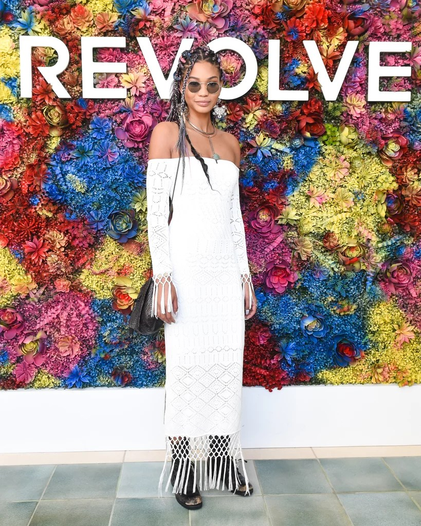Chanel Iman wearing a crochet off-the-shoulder dress at the Revolve Festival party.