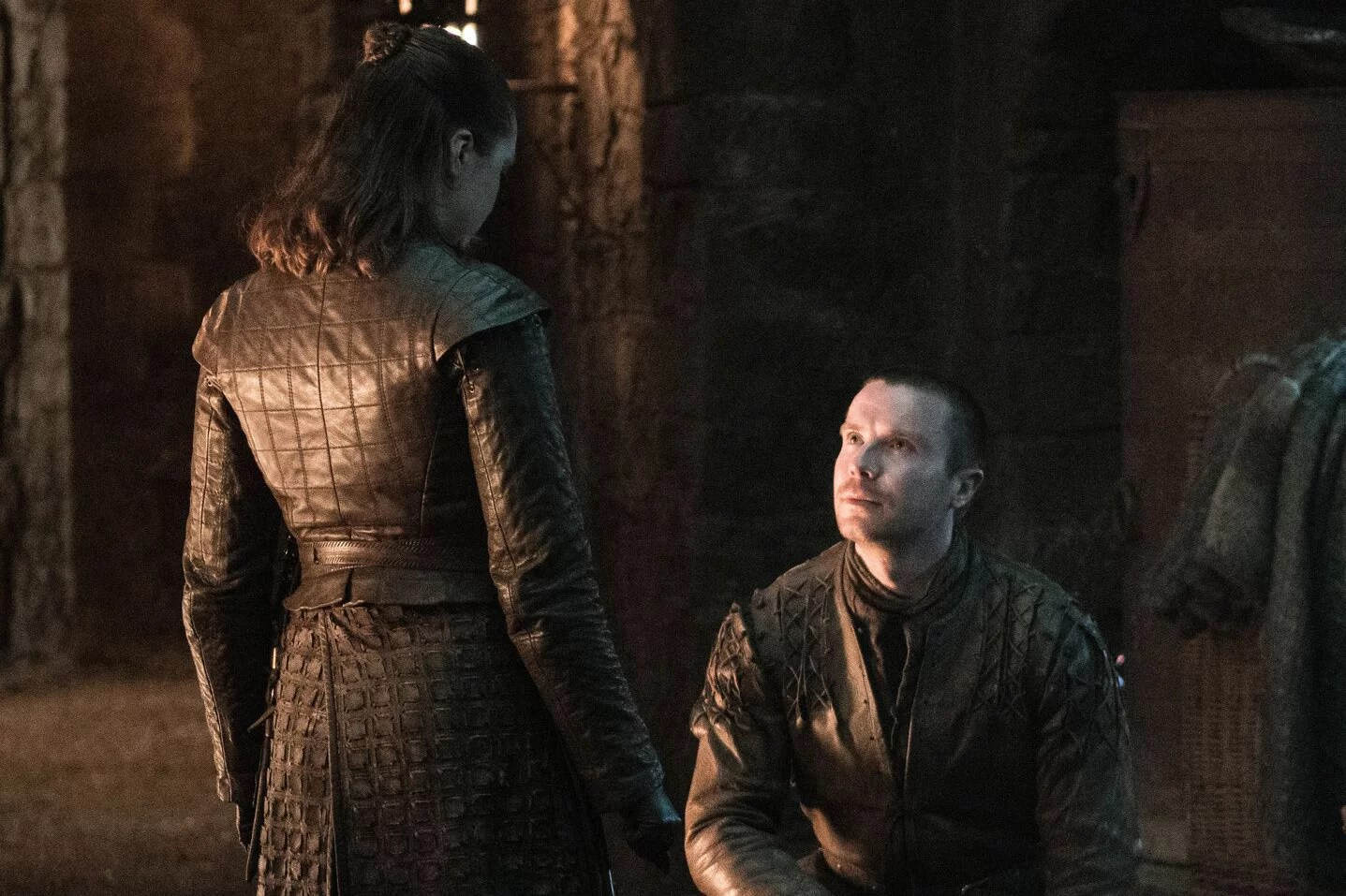 Gendry sitting in front of Arya
