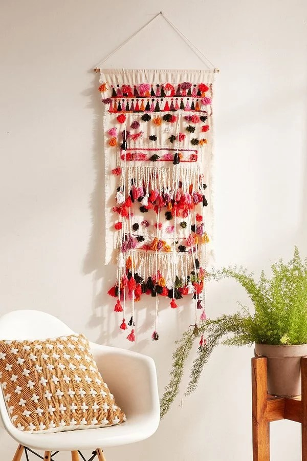 hanging chair urban outfitters table chairs rental pom wall 79 best home decor products from