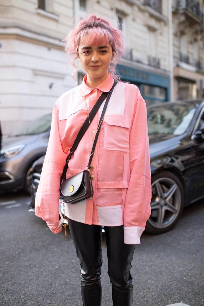 PARIS, FRANCE - JANUARY 16:  Maisie Williams is seen on the street during Paris Men's Fashion Week wearing pastel pink jacket with black shoulder bag and black pants with brown boots on January 16, 2019 in Paris, France. (Photo by Matthew Sperzel/Getty Images)