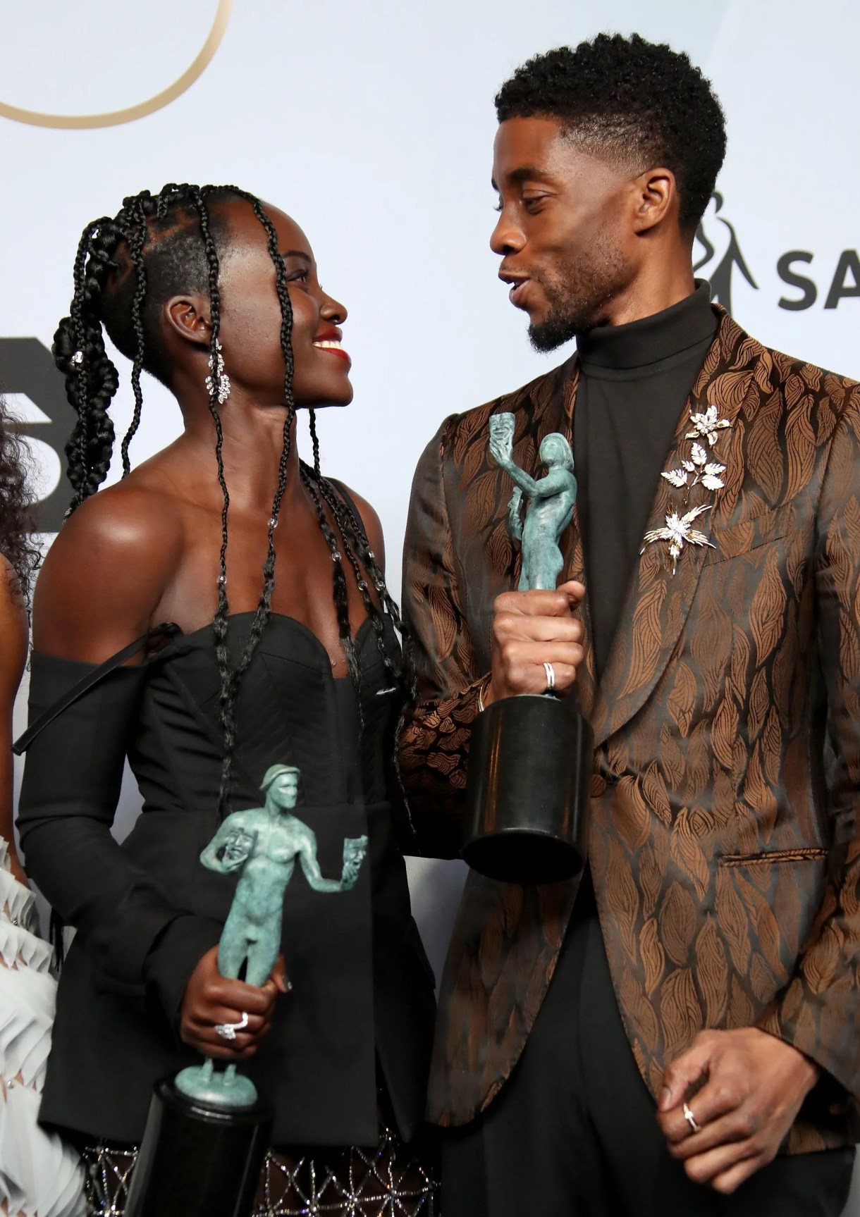 LOS ANGELES, CA - JANUARY 27: Lupita Nyong'o and Chadwick Boseman, winners of Outstanding Performance by a Cast in a Motion Picture for 'Black Panther,' pose in the press room during the 25th Annual Screen Actors Guild Awards at The Shrine Auditorium on January 27, 2019 in Los Angeles, California. (Photo by Dan MacMedan/Getty Images) *** Local Caption *** Lupita Nyong'o; Chadwick Boseman