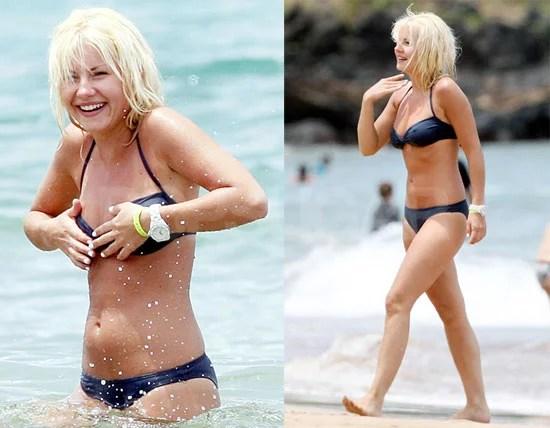 Elisha Cuthbert Avoids A Nip Slip Showing Off Her Bikini