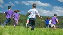 Kids Running On Grass