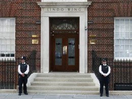 Image: Police officers stand in front of the Lindo Wing of St Mary's Hospital, where Britain