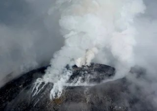 "Image: An aerial view shows the crater of the Mexican Colima or ""Fire"" Volcano spewing gas and ash in this handout photo released to Reuters by Civil Protection of Jalisco"