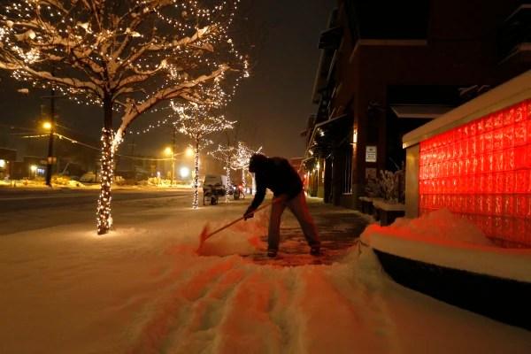 Image: Rick Velasquez shovels fresh snow during a winter storm in Boulder