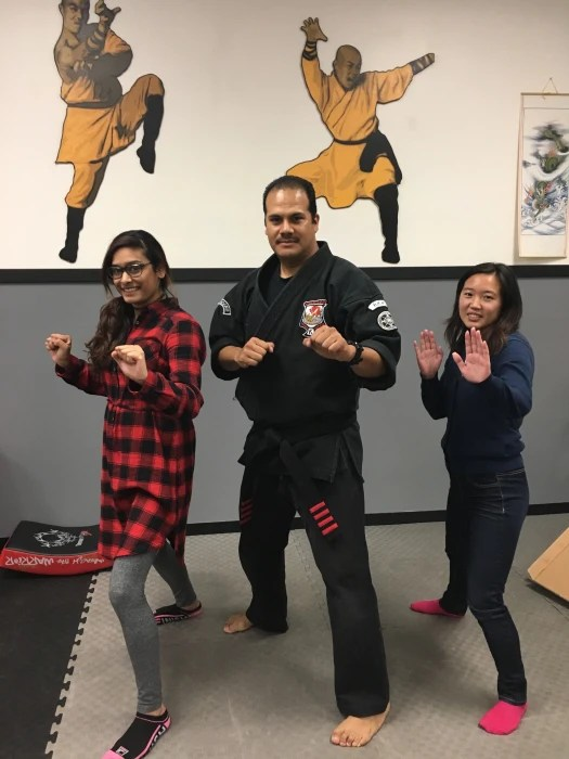 Contributor Monica Luhar (left) practice one of the poses she learned with Maurice Gomez (center) and friend Candy Ng.
