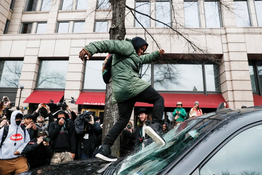 What right does this protester have to destroy someone else's property?