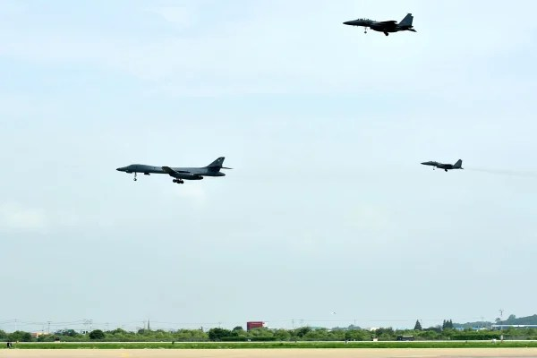 Image: This handout from the South Korean Defence Ministry in Seoul taken and released on July 30, 2017 shows a U.S. Air Force B-1B Lancer (L) flying with South Korean F-15K fighter jets over U.S. Osan Air Base in Pyeongtaek.