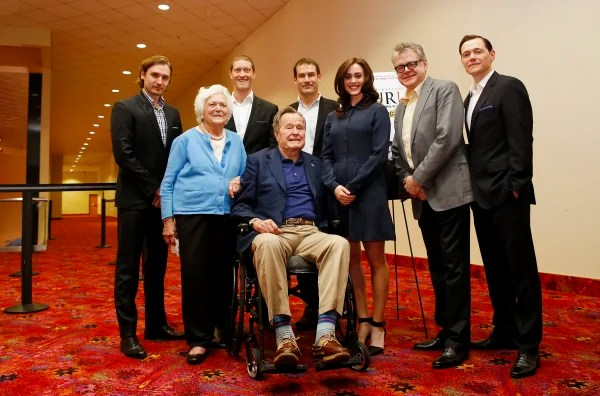 Image: Former President George H.W. Bush poses for a photo with the cast of AMC's series TURN