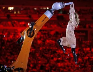 64ea42197d8 Amy Purdy wears a 3D-printed dress as she dances with a robot during the  opening ceremony of the 2016 Paralympics. Mauro Pimentel   AP file. ""