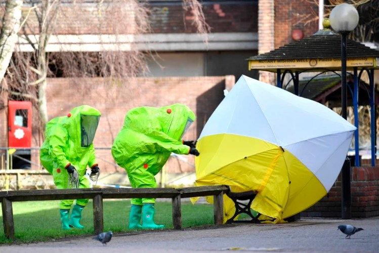 Image: Emergency officials work at the scene of an investigation in Salisbury