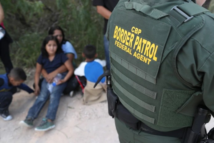 Image; Border Patrol Agents detained migrants near the US-Mexican border