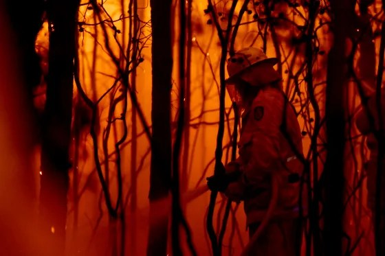 Image: A firefighter battles a bush fire near the town of Sussex Inlet on Dec. 31, 2019.