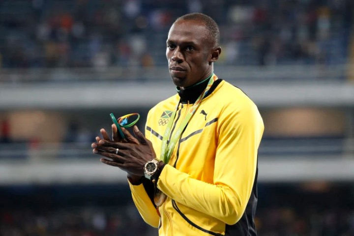 Usain Bolt with his gold medal on the podium of the men's 100-meter dash in Olympic Stadium in Rio de Janeiro on Aug. 15, 2016.
