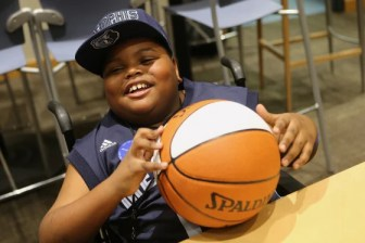 Charvis Brewer, the newest and youngest member of the Memphis Grizzlies, beams with excitement on Sunday.