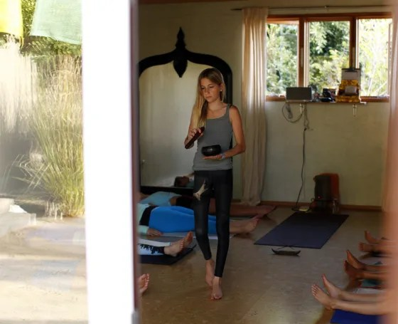 Jaysea DeVoe, 12, teaches her yoga class at the Bergamot Spa in Encinitas, Calif.