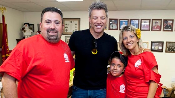 The Carpino family posing with Jon Bon Jovi for a photo.