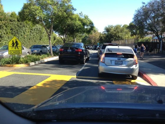 Hey, black car -- we see you trying to cut into the school pick up line. You are violating Rule #4 !