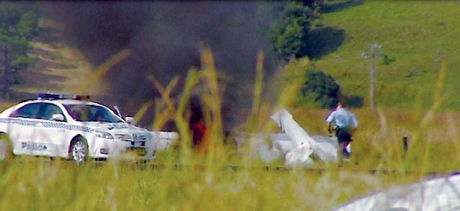 TRAGEDY: Police inspect the wreckage of an Ultralight RV12 that crashed yesterday morning at the Lismore Airport, killing well-known pilot Wayne Fisher.