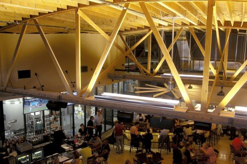 A sliver of the main dining area, viewed from the second floor. You can see part of the brew house at lower left.