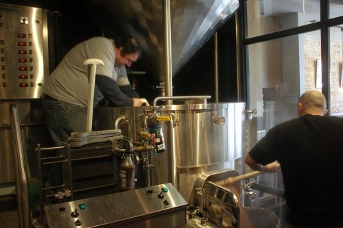 Dubovick and DryHop brewer Adrian Vidaurre during grain out for a forthcoming India brown ale