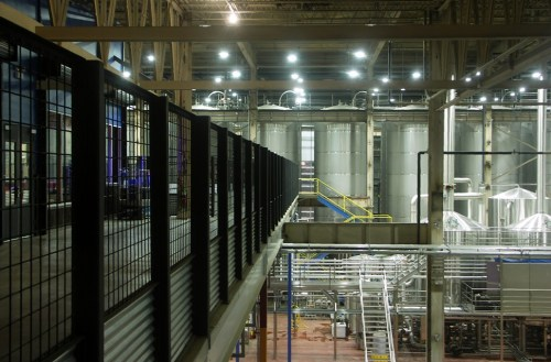 I overheard a tour guide explaining that these 750-barrel fermenters are supported by 35-foot beams sunk into the bedrock beneath the brewery.