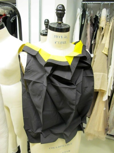 Its a top made with recycled PET polyester by Issey Miyake!
